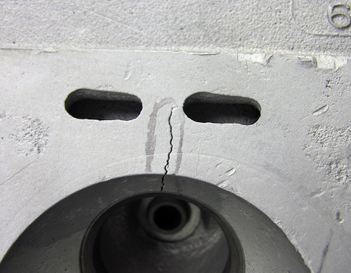 Cracks typically form when a cylinder head undergoes too much thermal stress. Loss of coolant, severe overheating as well as sudden changes in operating temperature from hot to cold can all create the kind of conditions that cause cracks to form.