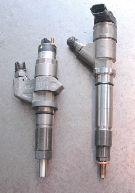 The injector on the left from a Duramax was used under the valve cover and inside the engine oiling system prior to model year '04. Halfway through that year, the cylinder head and valve cover were changed to place the fuel injectors outside the lubricating oil eliminating any chance of fuel dilution of the oil. Technology obviously continues to evolve.
