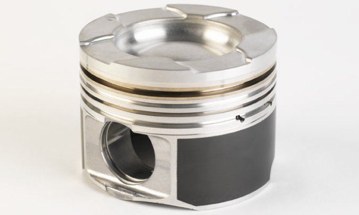 Cast Duramax piston with steel top ring land insert