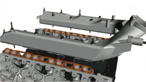 When reinstalling the intake  manifold, the locating tabs on the  intake manifold gasket should face up and toward the center of the engine.