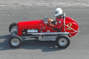 This vintage pavement midget uses a stock V8-60 powerplant.