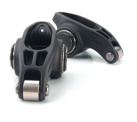 In high stress applications, one of the most common failure points for a rocker arm is at the trunion straps or the trunion itself. Steel has a distinct advantage over aluminum because it can handle more stress with less material.