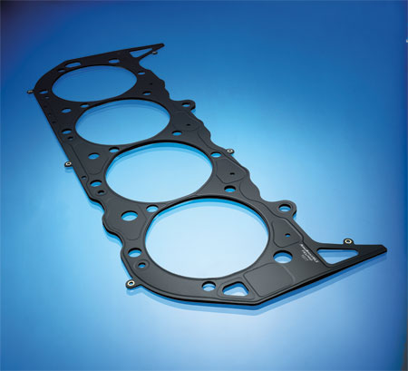 mls head gaskets are made of several layers of embossed stainless steel (most are 3 or 4 layers thick, but some have more). a thin coating (.001? to .0015?) of nitrile rubber or viton is used on the external surfaces as well as between the layers to provide maximum sealing.