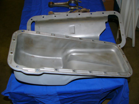 this is an example of a ford fe pan with the infamous finned baffle. always reinforce the fin's welds. this should be used with windage tray pictured.