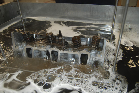 the photo shown here and on the following pages show a cylinder head before during and after cleaning in a parts washer equipped with ultrasonics and vertical agitation.