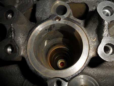 figure 1 - this is the stock injector sleeve inside the injector bore that is going to be replaced. when performing a rebuild this is a must. one thing that makes the whitaker tool unique is that if there are any injector sleeve issues on the vehicle like fuel getting into the coolant, the tool from whitaker can be used in the engine compartment to replace the sleeve. the cylinder head does not have to come off.