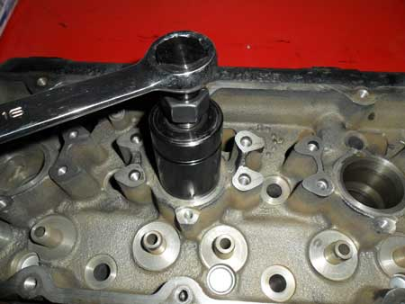 figure 3 - install the puller into the injector bore and using the bolt at the top, thread the puller into the injector sleeve.