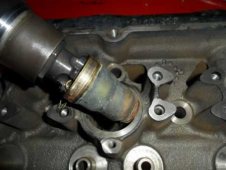 figure 4 - once the old sleeve is removed, you can see how the tool threaded into the injector cup. you can also see the condition the injector cup was in. remember in order to cool the injector, the bore is placed inside the coolant passage. the coolant is separated from the injector by the sleeve.