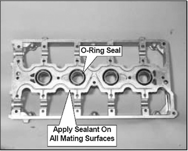 Figure 2 The cam carrier requires an oil tight seal between it and the cylinder head. This is accomplished with four special O-ring seals around the spark plug cavities, and by using a sealant on the mating surfaces.