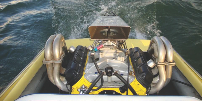 Tuf-Enuf's work in motion. This engine is a 455 Oldsmobile with highly modified cylinder heads and a solid roller cam sitting in a '79 Biesemeyer jet boat. The engine puts out 680 hp.