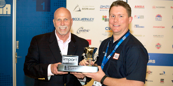 Dan Clarke (right), Permatex Senior Product Manager, accepts the 2016 Import Product and Marketing Awards for Best Merchandising/Advertising from Ira Davis (left), Chairman of the Import Vehicle Community.
