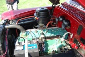 The underhood area of a 1950 Pontiac Eight owned by Chris Wynstra of Franksville, WI, looks pretty much the way other straight eight Pontiacs do, but sometime during its existence this car was converted to propane power.