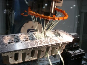 High speed CNC porting tooling requires plenty of coolant to flush away chips and to carry away heat.