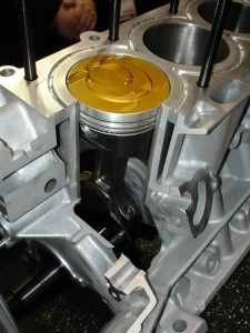 Top thermal barrier coatings are used on some gas direct injection engines to reflect heat.