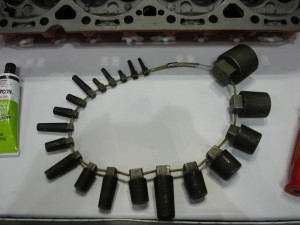 This series shows tapered plugs used to fill cracks in a cylinder head. Tapered plugs are installed, cut off, peened, then finished. At the bottom, a  selection of different plug sizes is seen.