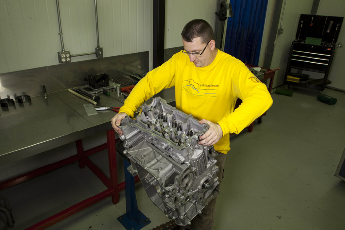 Jake Raby works on water-cooled Porsche engines. He created a niche for his business by fixing one of Porsche's faulty bearings that caused engine failure. Photo courtesy of Raby Enterprises, Inc.