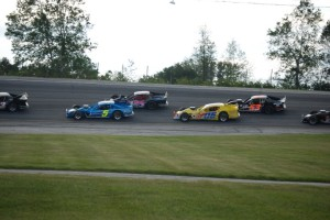 Cars circle the track in the Modified Racing Series.